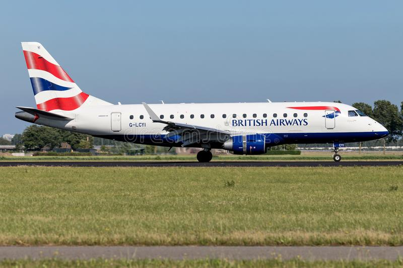 British Airways. Embraer ERJ-175 operated by BA Cityflyer with registration G-LCYI just landed on runway 18R Polderbaan of Amsterdam Airport Schiphol royalty free stock photo