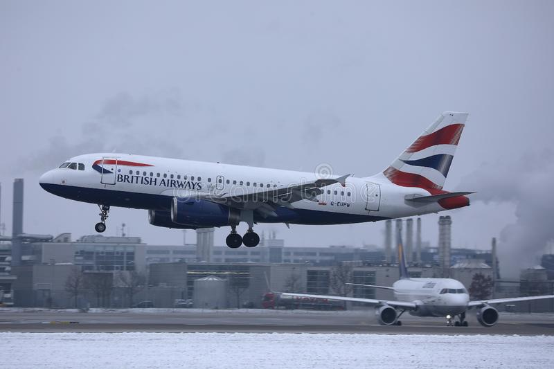 British Airways Airbus landing on snow, MUC Airport. British Airways jet doing taxi in Munich Airport, Munchen Flughafen. Winter with snow stock photo