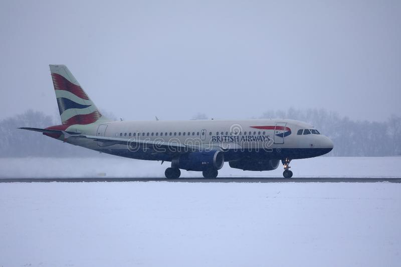 British Airways Airbus taxiing on snow, MUC Airport. British Airways jet doing taxi in Munich Airport, Munchen Flughafen. Winter with snow royalty free stock photo