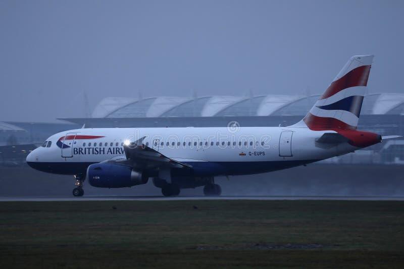 British Airways plane taxiing on Munich Airport, MUC. British Airways jet doing taxi on runway stock photos