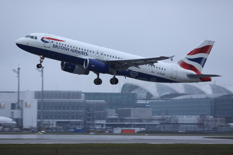 British Airways plane taking off from Munich Airport, MUC. British Airways jet doing taxi on runway stock images