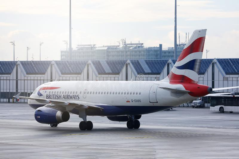 British Airways plane taxiing in Munich Airport, MUC. British Airways jet doing taxi on runway royalty free stock photography