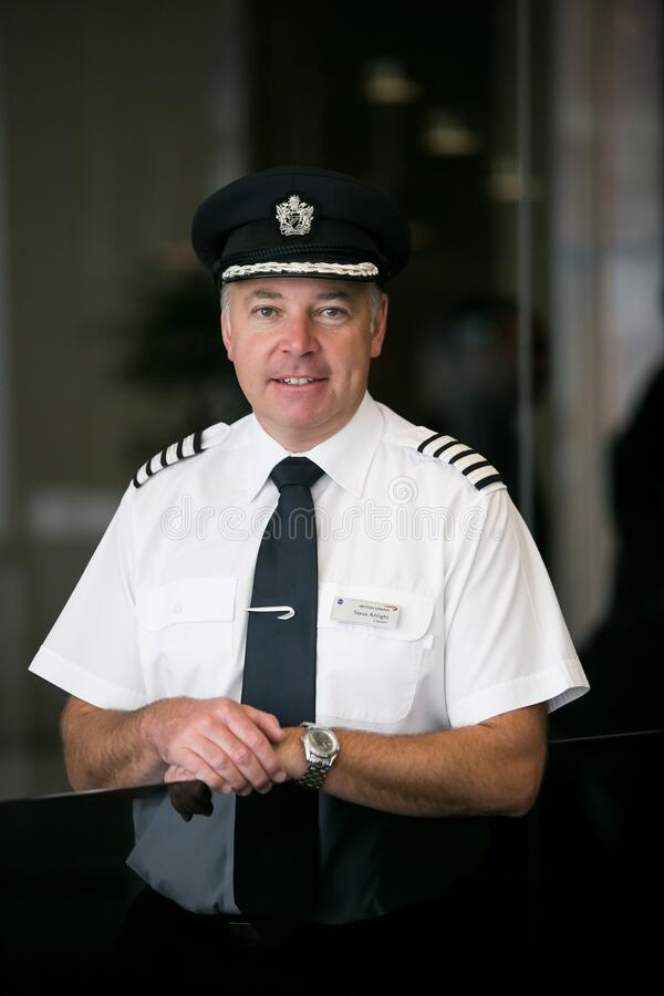 British Airways Middle Aged Caucasian Male Captain Pilot. Johannesburg, South Africa - September 29, 2014: British Airways Middle Aged Caucasian Male Captain royalty free stock images