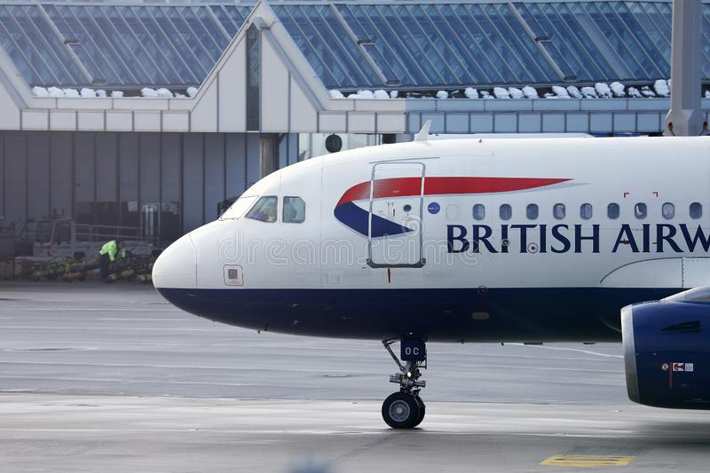 British Airways plane, close-up view of cabin crew. British Airways jet doing taxi on runway stock image