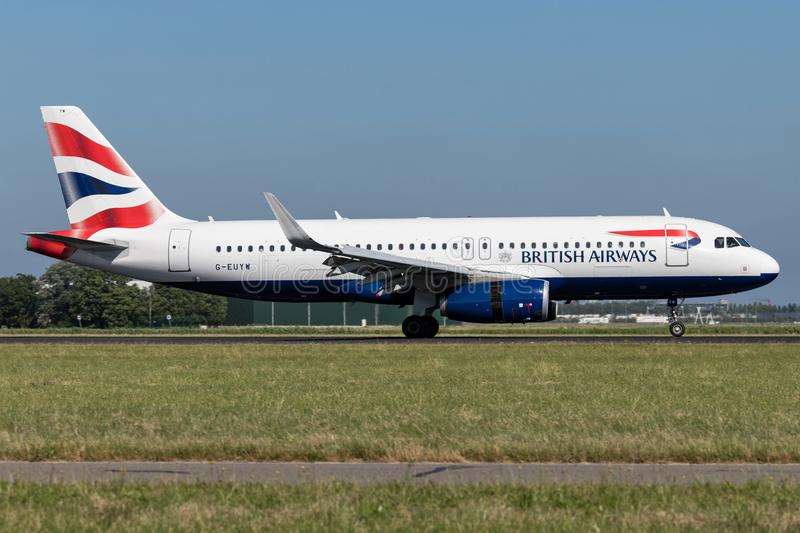 British Airways. A320-200 with registration G-EUYW just landed on runway 18R Polderbaan of Amsterdam Airport Schiphol royalty free stock photo