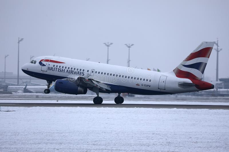British Airways taking off from MUC Airport, snow. British Airways jet doing taxi in Munich Airport, Munchen Flughafen. Winter with snow royalty free stock images