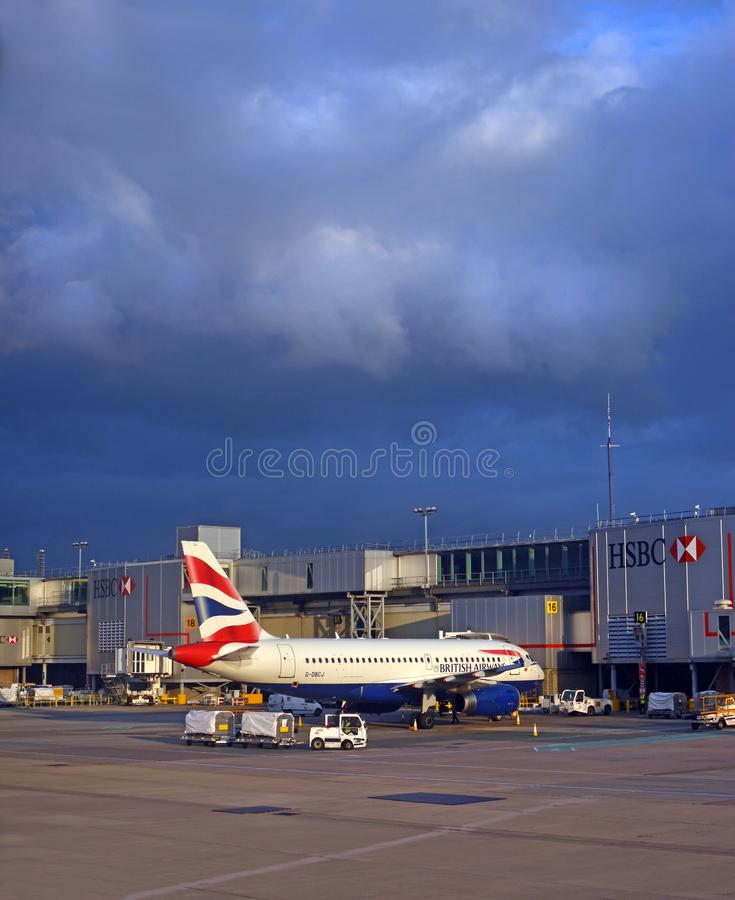 British Aiways Jet Airliner being loaded in storm at Gatwick royalty free stock image