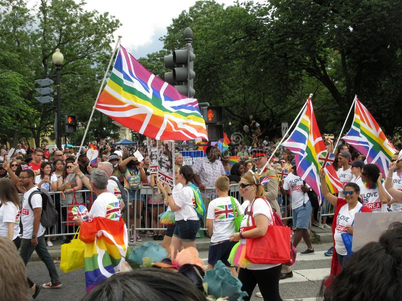 British Capital Pride Parade Marching. Photo of men and women marching at the capital pride parade in washington dc on 6/9/18. This parade takes place at dupont royalty free stock photography
