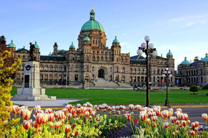 British Columbia provincial parliament building with spring tulips stock photography