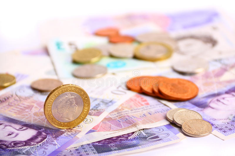 British currency. Pack of british currency, banknotes and coins royalty free stock photography
