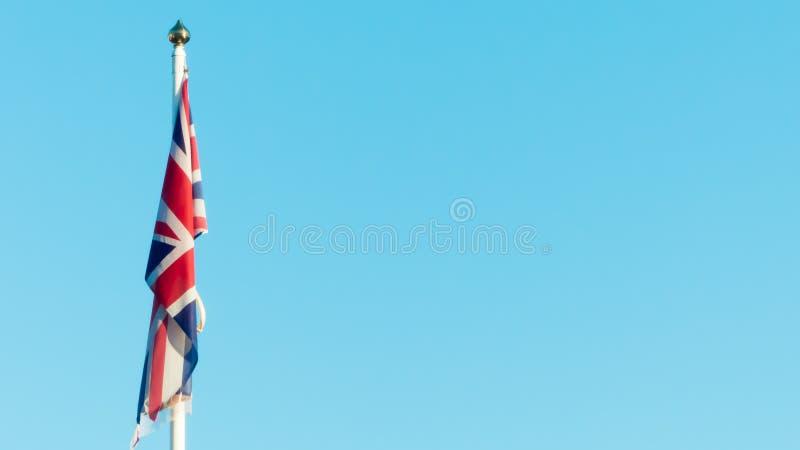 British flag against blue sky stock photography