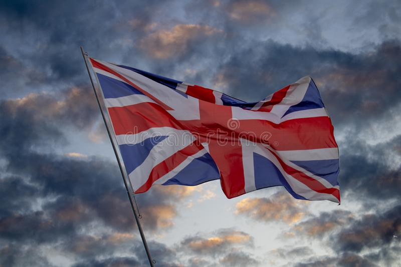 British flag. The british flag with dark clouds in the background stock photo