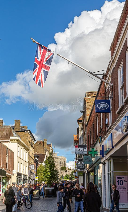 British Flag Over Windsor Street. WINDSOR, UK - October 1, 2016: Windsor Castle is a royal residence at Windsor in the English county of Berkshire. The town of royalty free stock photos