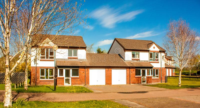 British Household. A typical British house, semi detatched with a garage and grass garden out front stock image