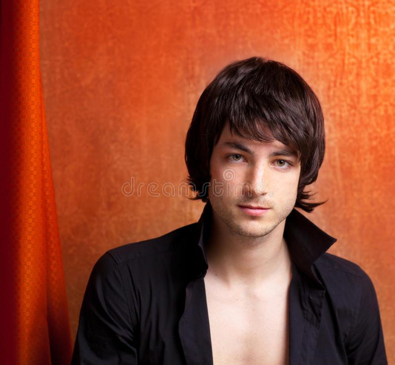 Download British Indie Pop Rock Look Young Man On Orange Stock Image - Image of male, brown: 24167461