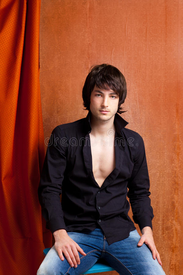 Download British Indie Pop Rock Look Young Man On Orange Stock Image - Image: 24167651