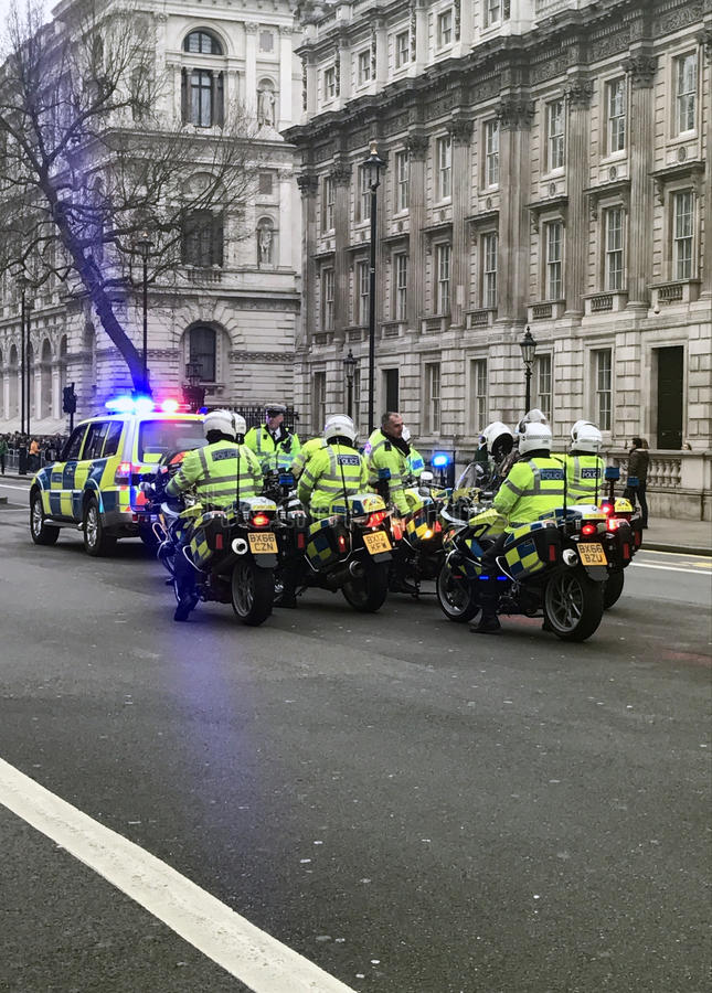 British Metropolitan Police Officer riding Motorbike on Syrian Protest/March stock images