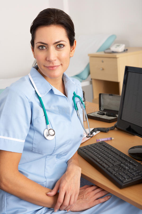 British nurse sitting at desk at work royalty free stock photo