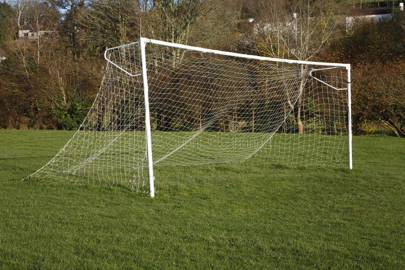 British park football pitch goal posts and net. stock photos