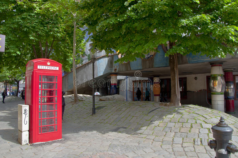 British phone booth near Hundertwasser House in Vienna stock photography