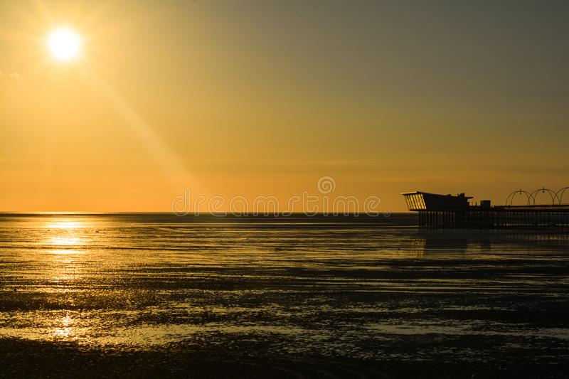 British pier at the sunset. stock image