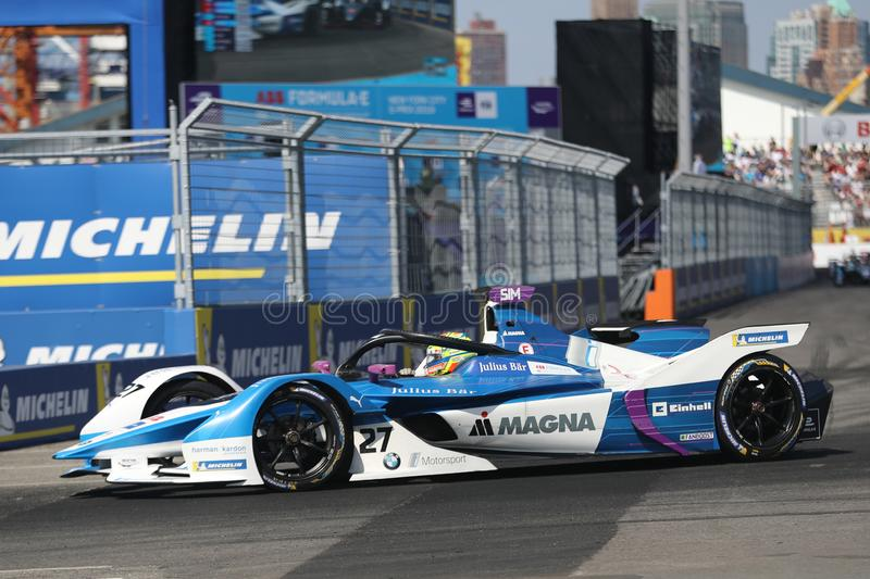 British professional racing driver Alexander Sims of  BMW Andretti Team driving his Formula E car 27 during 2019 NYC E-prix. NEW YORK - JULY 14, 2019: British royalty free stock image