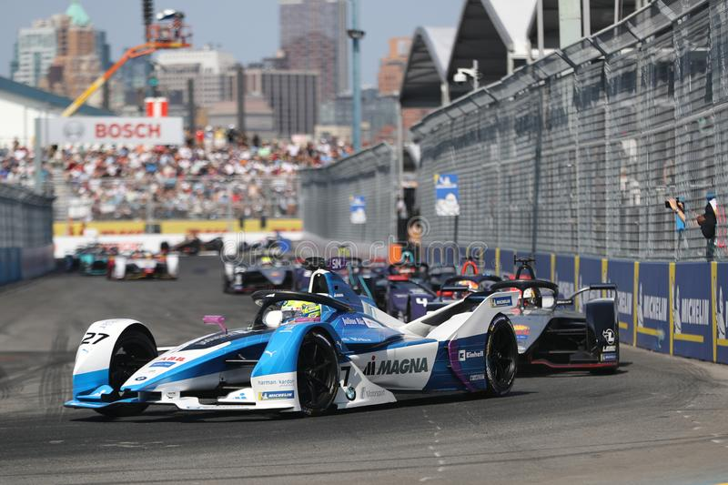 British professional racing driver Alexander Sims of  BMW Andretti Team driving his Formula E car 27 during 2019 NYC E-prix. NEW YORK - JULY 14, 2019: British royalty free stock photography