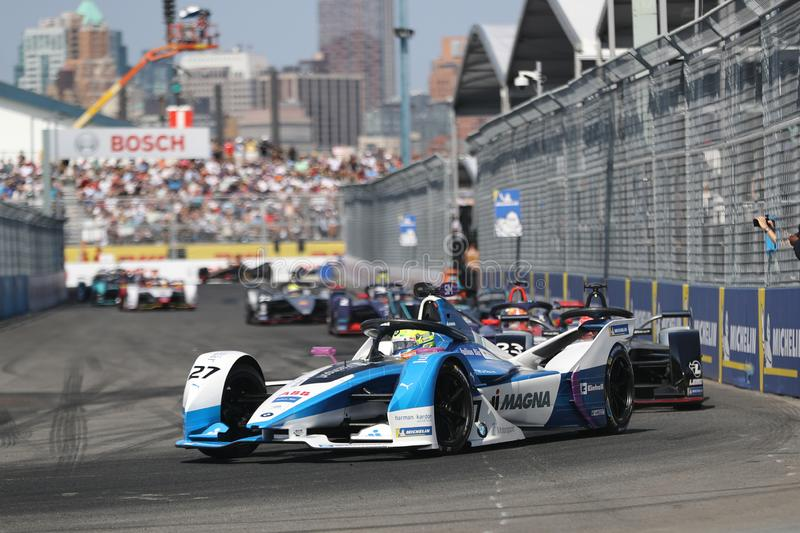 British professional racing driver Alexander Sims of  BMW Andretti Team driving his Formula E car 27 during 2019 NYC E-prix. NEW YORK - JULY 14, 2019: British stock photo