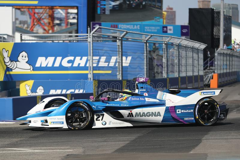 British professional racing driver Alexander Sims of  BMW Andretti Team driving his Formula E car 27 during 2019 NYC E-prix. NEW YORK - JULY 14, 2019: British stock photos