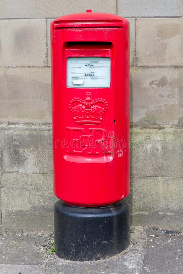 A bi-lingual British Red Postbox. A British red postbox with details  in Welsh and English, 19th April 2019, Bridgend, Mid Glamorgan UK stock image