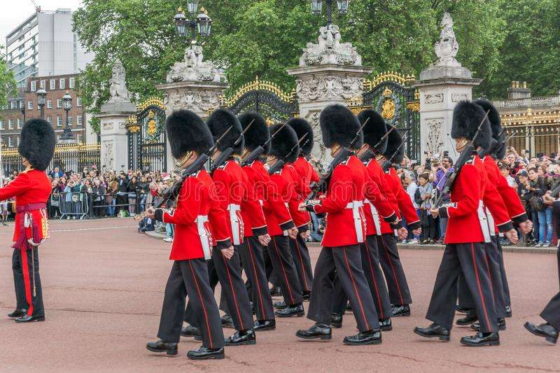 British Royal guards perform the Changing of the Guard in Buckingham Palace, London, England, Gre. LONDON, ENGLAND - JUNE 17, 2016: British Royal guards perform stock photos