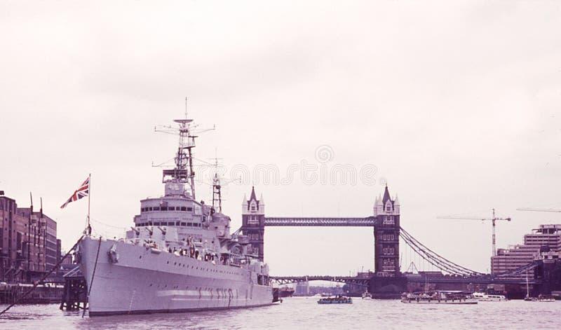 British Royal Navy ship on Thames River. Vintage image from the 1970`2 of a British Royal Navy ship on the Thames River. Image taken from color slide stock images