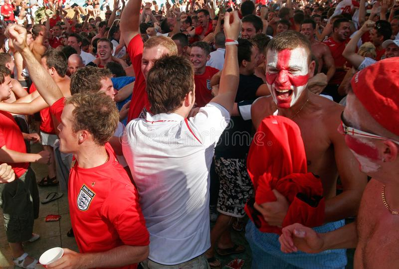 British supporters react while watching the world soccer championship games wide. British soccer team supporters celebrate a goal while spending their holidays stock photography