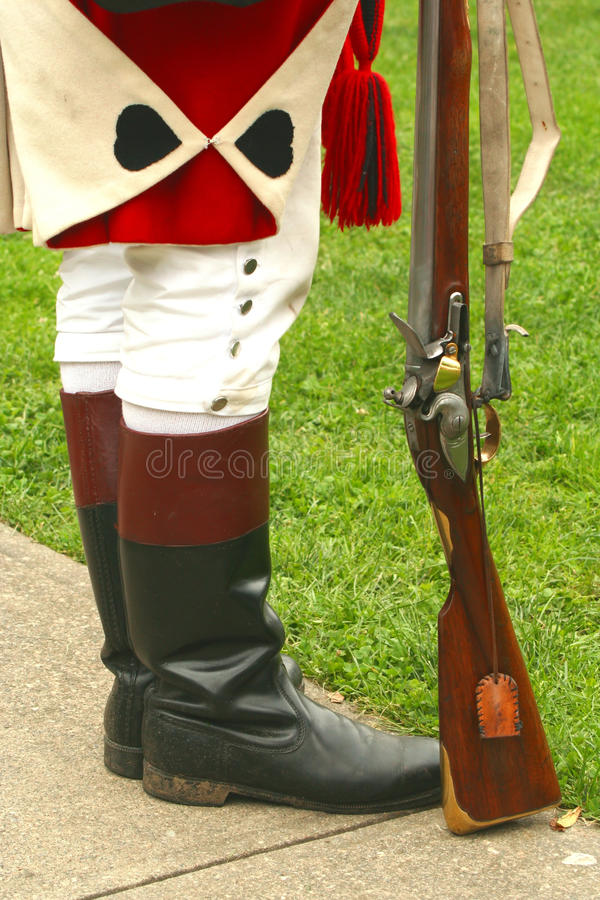 British Soldier--Revolutionary War Reenactment. A British soldier stands at attention during a Revolutionary War reenactment stock image