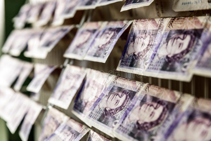 British Sterling Pounds Notes On Clothes Dryer. Money Laundering Concept stock image