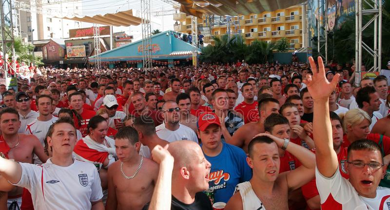 British supporters react while watching the world soccer championship games. British soccer team supporters celebrate a goal while spending their holidays at the stock photos