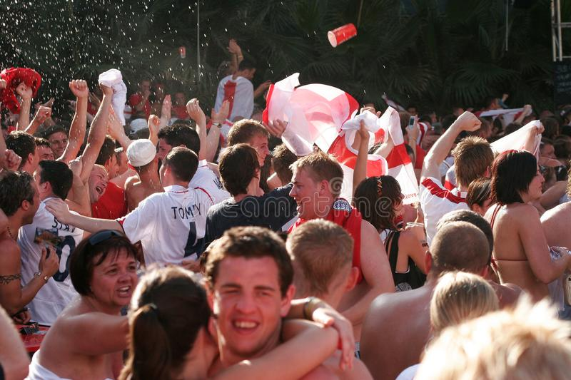 British supporters react while watching the world soccer championship games. British soccer team supporters celebrate a goal while spending their holidays at the royalty free stock images