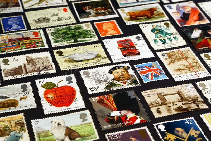 British symbols on postage stamps. The queen, Henry VIII, the London bridge, the flag, Prime meridian of Greenwich and other british symbols on postage stamps royalty free stock image