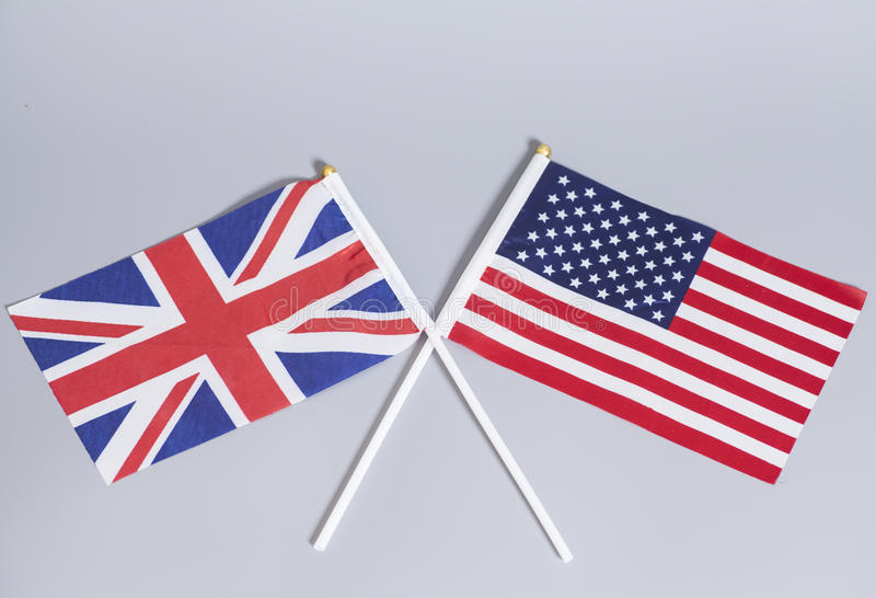 British (UK) and American flags. On gray background stock photo