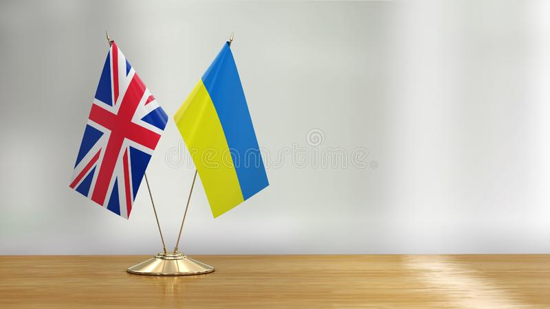 British and Ukrainian flag pair on a desk over defocused background. 3d Image of British and Ukrainian flag pair on a desk over defocused background vector illustration