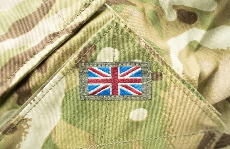 British Union Jack flag on a military uniform. Union Jack / union flag badge on a camouflage British army uniform. Text / writing space surrounding flag royalty free stock image