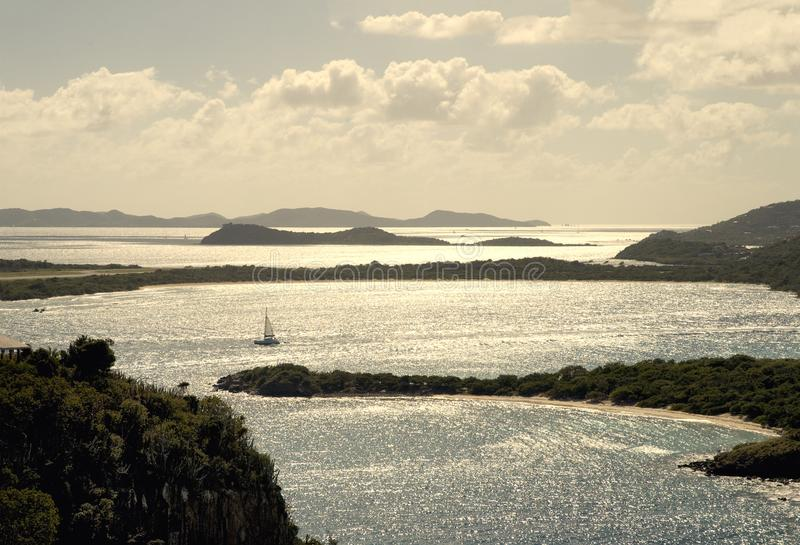 British Virgin Islands Caribbean Golden Hour. Sailboat and panoramic view from Great Camanoe Island to Tortola, Peter and Beef Island and little Camano on stock image