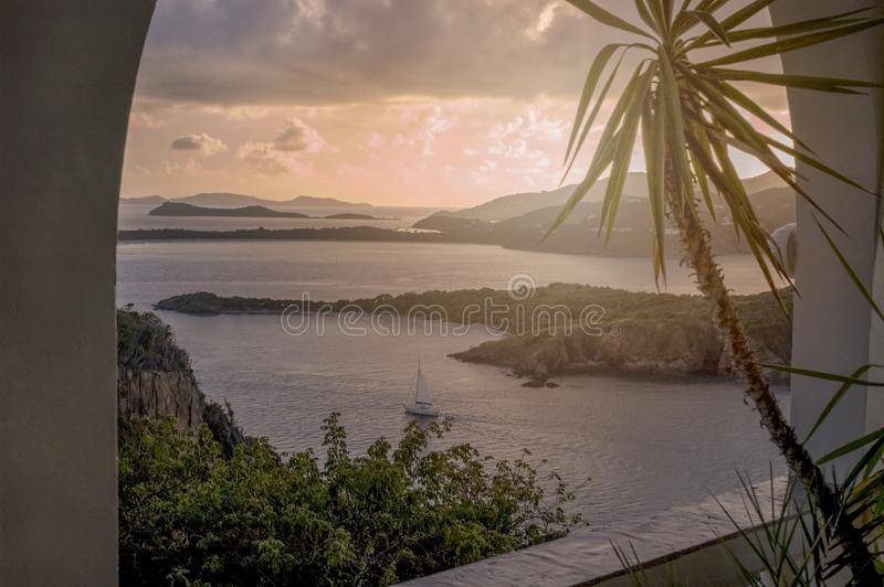 British Virgin Islands Caribbean Sunset Sailboat. Panoramic sunset with sail boat and view from Great Camanoe Island to Little Camanoe Island, Tortola and Beef royalty free stock photo