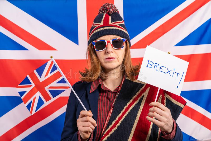 British woman UK flag and Brexit banner stock photos