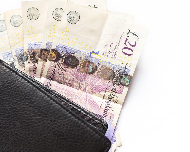 Brits geld Britse 20 ponden rekeningen en portefeuille stock afbeelding