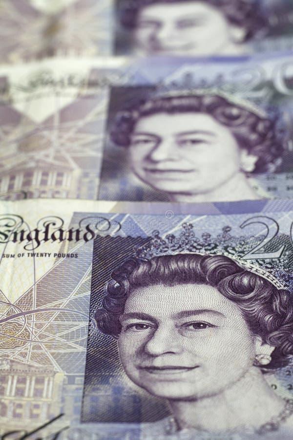 Britse munt Sluit omhoog van Britse 20 Pondenbankbiljetten stock foto's