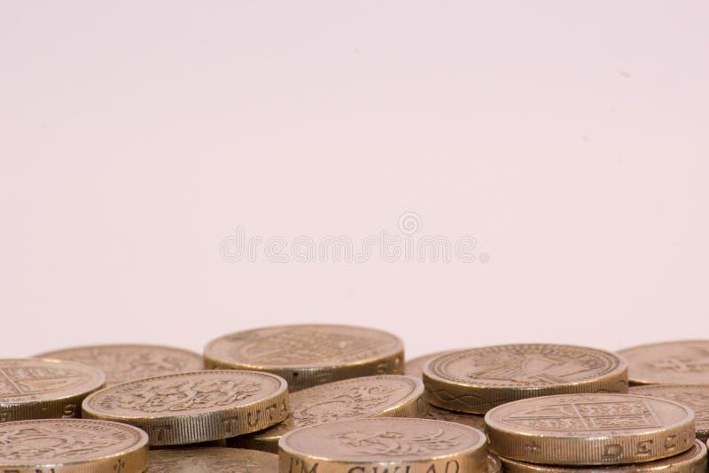 Britse Pondmuntstukken op witte achtergrond stock afbeelding