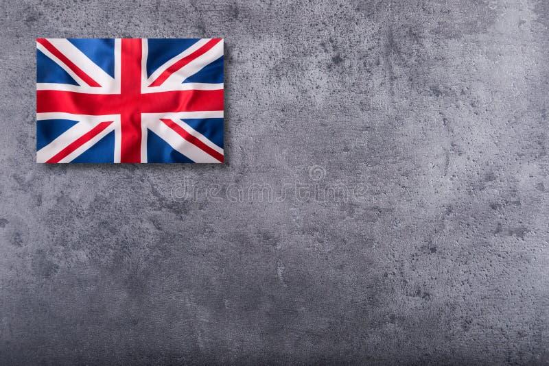 Britse Vlag Britse Union Jack-vlag op concrete achtergrond royalty-vrije stock afbeeldingen