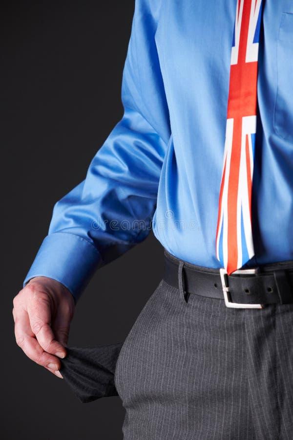Britse Zakenman Wearing Union Jack Tie Pulling Out Pocket aan royalty-vrije stock foto's