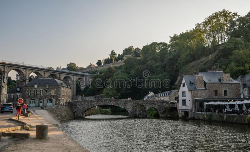 Sunset view of Medieval Dinan Port France with bridges and half-timbered buildings. royalty free stock photography